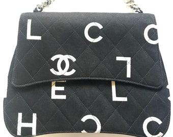 3e2a5bf7357 Vintage CHANEL black fabric canvas handbag with silver tone chain strap and white  Chanel CC logo print all over. Very unique shape.