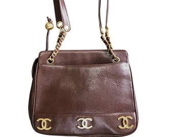 b9d88f5edf Vintage CHANEL brown caviar leather chain shoulder bag with 3 golden CC  marks on both sides. Classic purse.