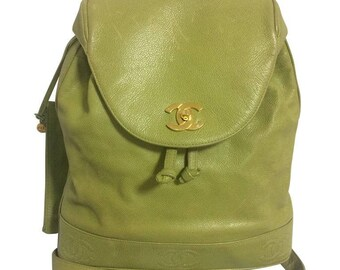a7b1db6d69 Vintage CHANEL green caviar leather backpack with gold chain strap and CC  closure. Classic but rare color.