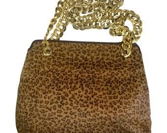 d4d7a024df Vintage Bottega Veneta genuine leather shoulder bag with allover faux  leopard print and double golden chain straps.