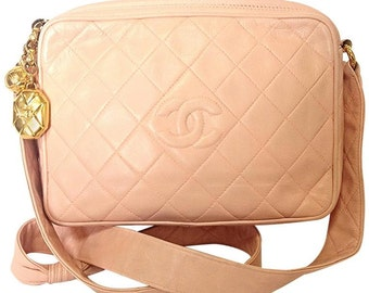 999fbc32fdec Vintage CHANEL milky pink lambskin camera bag style shoulder bag with  golden CC charms and CC stitch mark.
