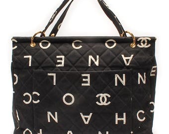 890f65c4e374 Vintage CHANEL black fabric canvas large tote bag with white Chanel CC logo  print all over. Must have daily use vintage Chanel purse.