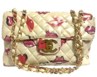 a0343ec79467 Vintage CHANEL cream color coated canvas 2.55 jumbo chain shoulder bag with CC  marks and pink and red lip illustration print. Rare.