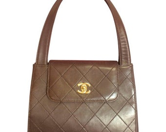 1447273af0 Vintage CHANEL chocolate brown leather trapezoid shape handbag with golden  CC closure. Classic purse.