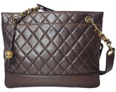 Vintage CHANEL gunmetal, bronze lambskin tote bag with gold tone shoulder strap chains and golden CC ball charm.
