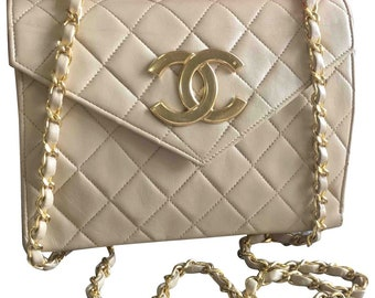 869a2d70ba14 Vintage CHANEL beige lambskin chain shoulder purse with large CC beak flap  tip. Classic 2.55 bag with envelope style flap.