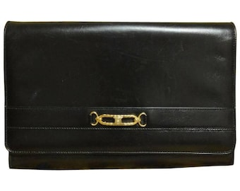 a6d57c65b5 Vintage Celine black calfskin leather clutch purse with iconic golden  blason macadam charm at front. riri zipper