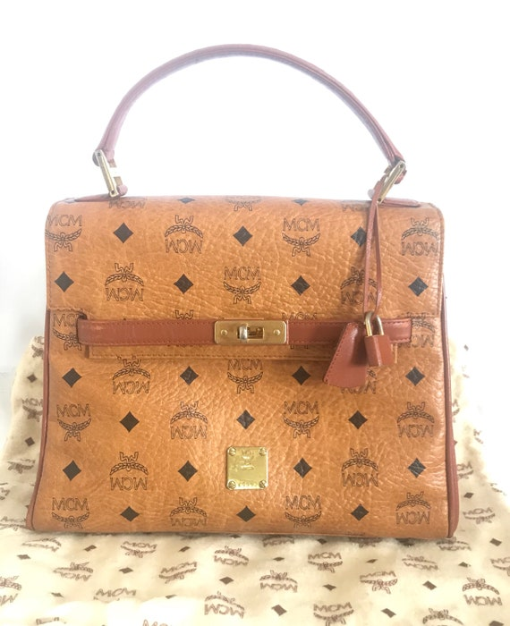 Vintage MCM classic brown monogram Kelly bag with golden logo plate. Perfect daily use bag. By Michael Cromber, Germany.