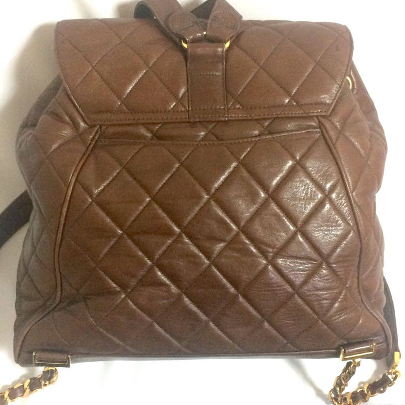 6ef5abf5a7 Vintage CHANEL quilted brown lamb leather backpack with gold