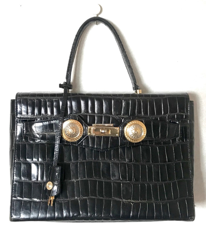 1f3a0e85 Vintage Gianni Versace black croc embossed leather Kelly style bag with  Medallion Sunburst motifs. Gorgeous masterpiece. Must have bag.