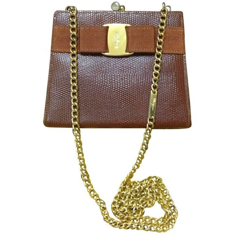 Vintage Salvatore Ferragamo brown lizard embossed leather golden chain  clutch bag with vara gancini collection. Kiss lock closure purse. 4b4a558e7cd0d