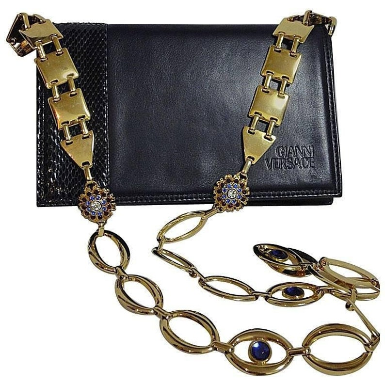 fd6cecb023 Vintage Gianni Versace navy leather clutch shoulder purse with snakeskin  and golden parts and crystal, blue, and red jewel stones.