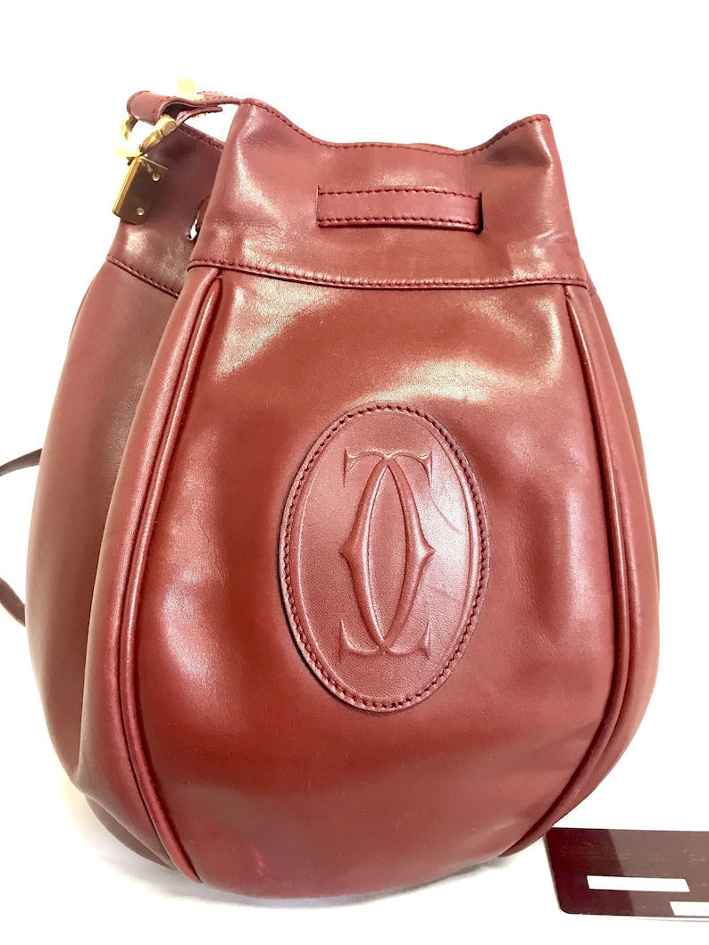 11337bc59afa Vintage Cartier wine leather tulip 3 dimension round hobo