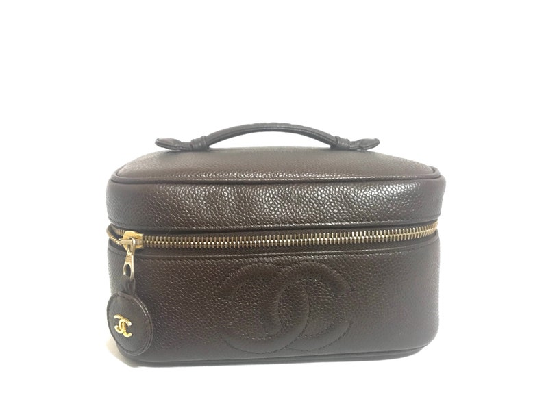 41b3aec97efb Vintage CHANEL dark brown caviar leather cosmetic and toiletry
