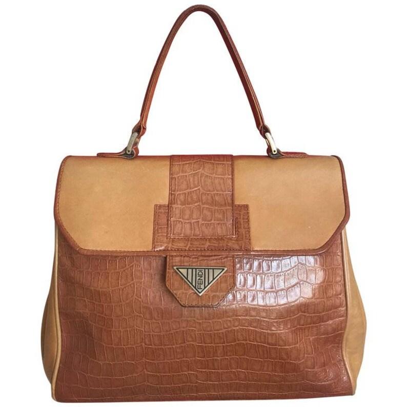 ba012fe47000 Vintage Fendi genuine brown leather kelly style handbag with