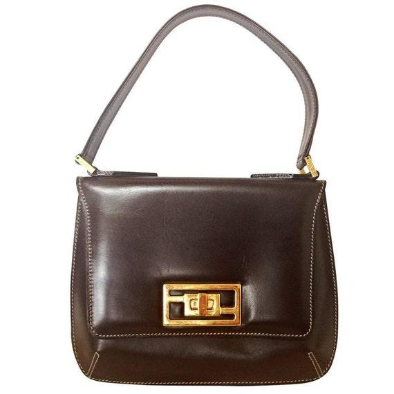 8095de93f4d0 Vintage Fendi genuine dark brown leather handbag with golden