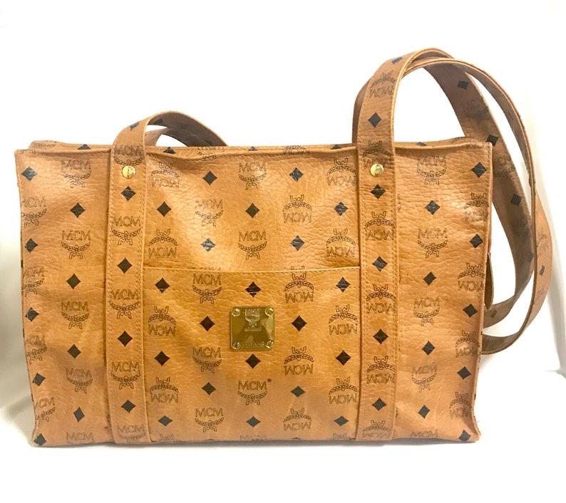 698a0deb3 Vintage MCM brown monogram large tote bag with long straps. | Etsy