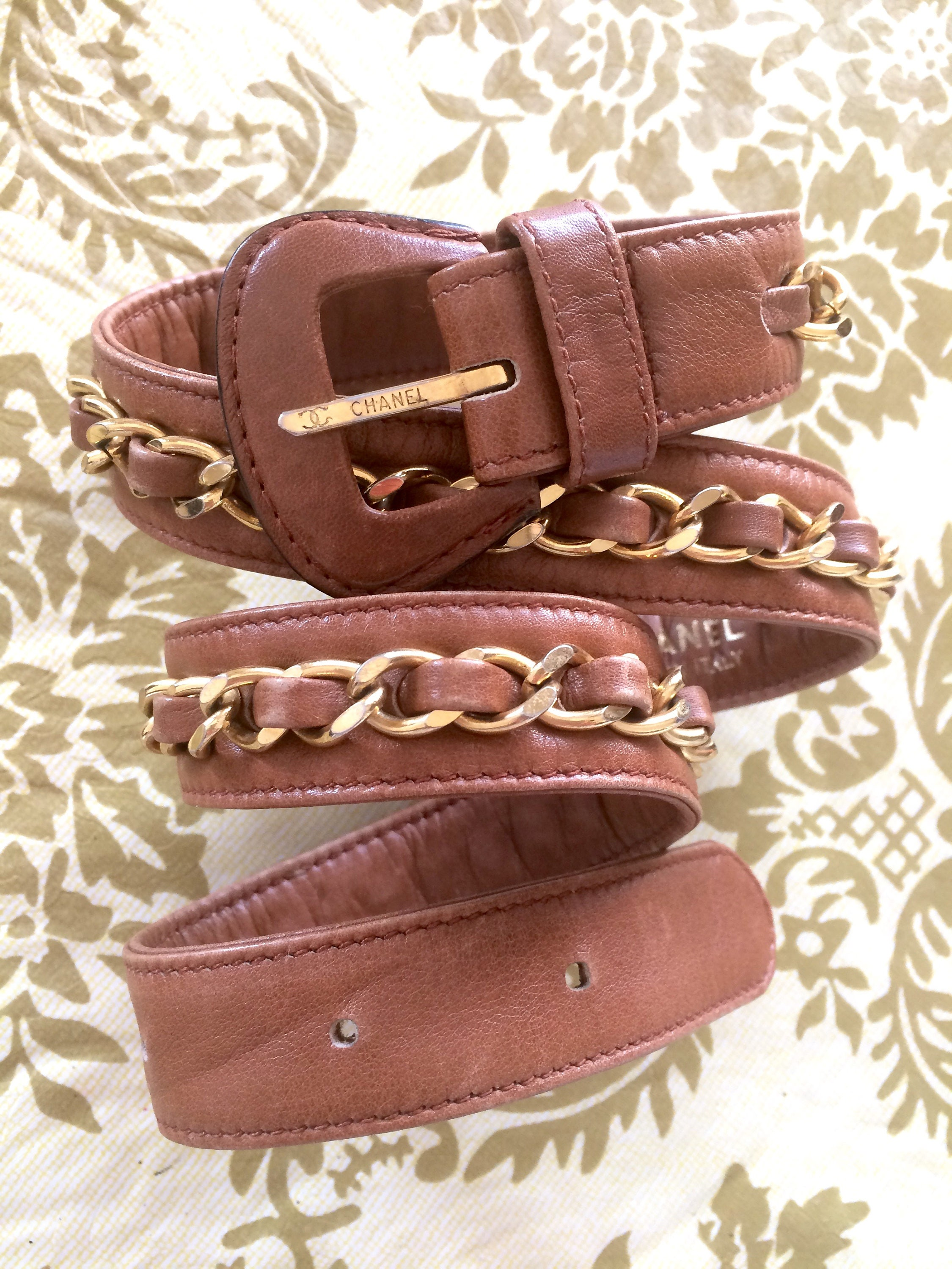 927c850211e6 Vintage CHANEL brown leather belt with gold tone chains.