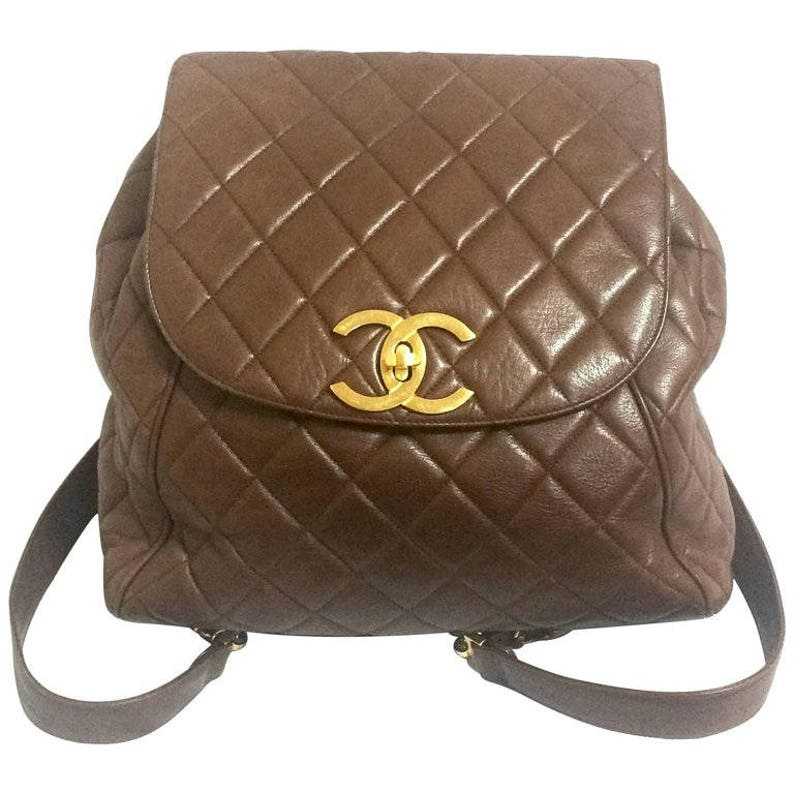 afc6413f384c6 Vintage CHANEL quilted brown lamb leather backpack with gold