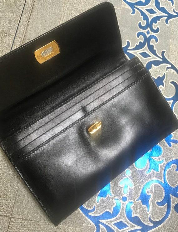 Vintage Salvatore Ferragamo Gancini black leather wallet with gold tone closure. Classic purse.