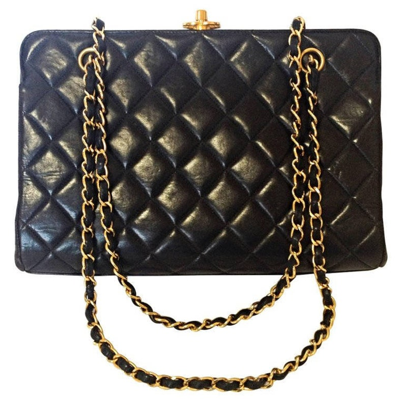 9052284fb984f3 Vintage CHANEL black lambskin golden chain shoulder bag with | Etsy
