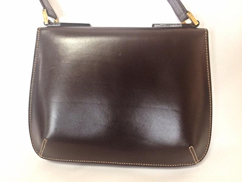 71291ce103 Vintage Fendi genuine dark brown leather handbag with golden