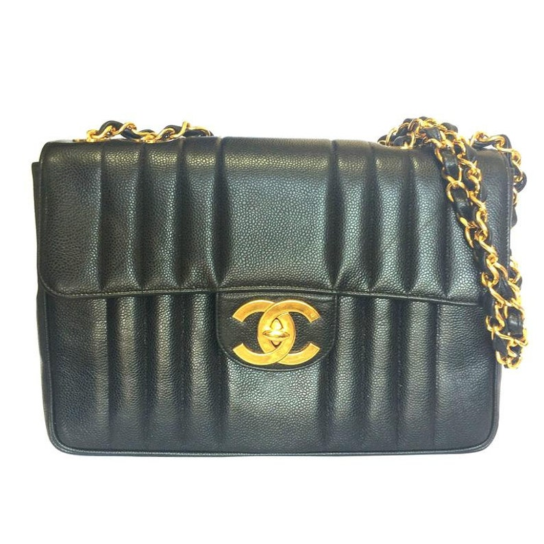 8156b422f0b7 Vintage CHANEL black 2.55 jumbo caviar leather large shoulder