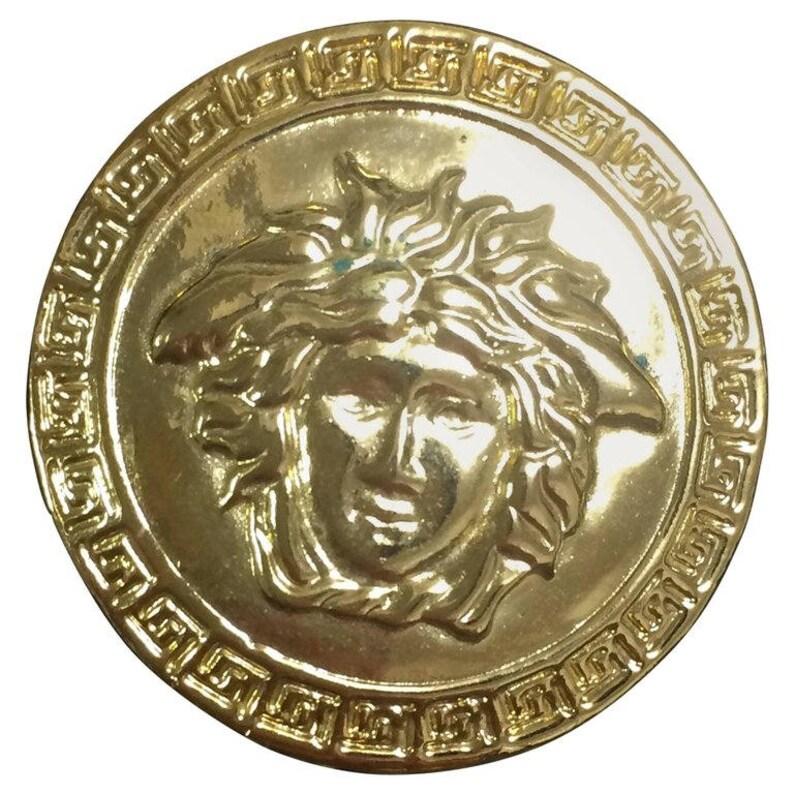 2a785d3d7d MINT. Vintage Gianni Versace gold tone medusa motif round