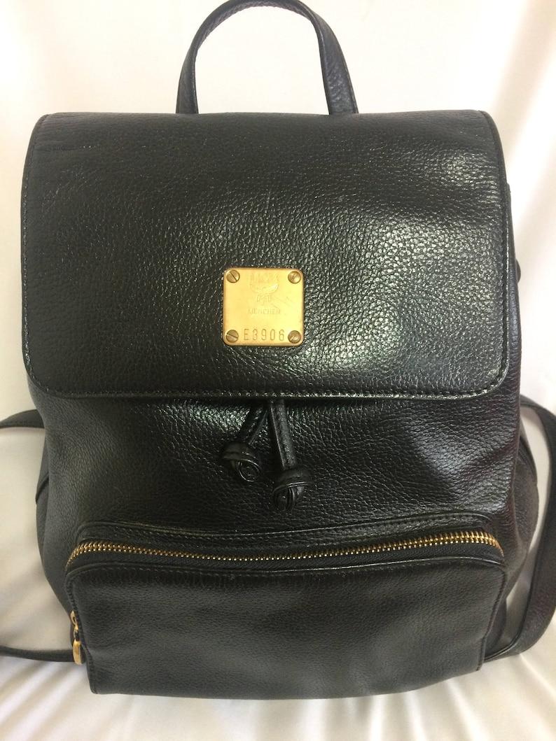 a57f45d4208171 Vintage MCM black leather backpack with golden studded logo | Etsy