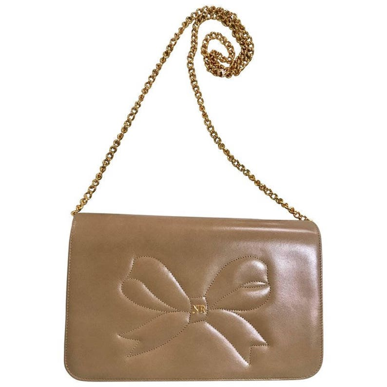 e9379fcd73 NEW with tag MINT. Vintage Nina Ricci beige leather clutch