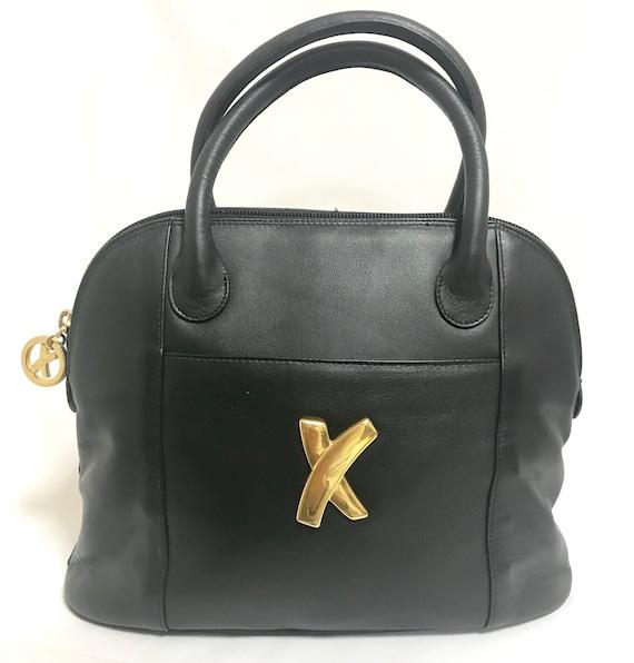 Vintage Paloma Picasso black leather bolide bag style handbag with iconic golden logo motif. Classic shape bag.