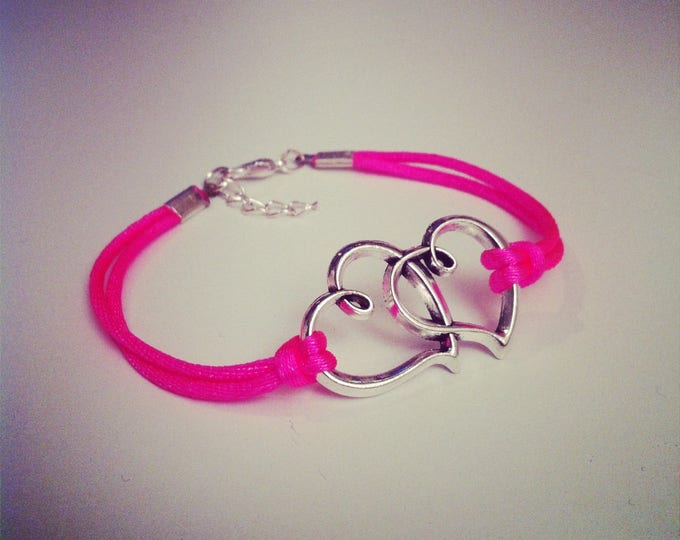 Big bracelet neon pink cord with two entwined hearts