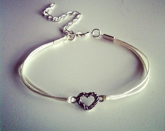 White cord with small silver heart bracelet