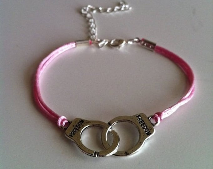 Pale pink cord with silver handcuffs bracelet