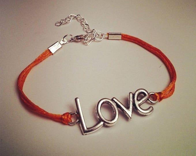 Orange cord bracelet with LOVE silver