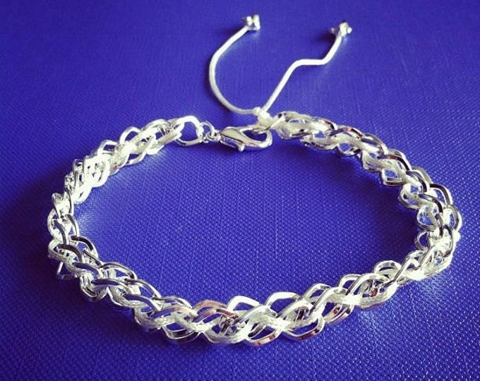 Silver plated chain with off white cord bracelet