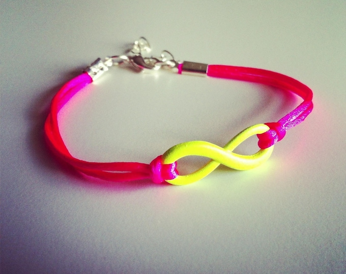 Neon pink cord with yellow infinity sign bracelet