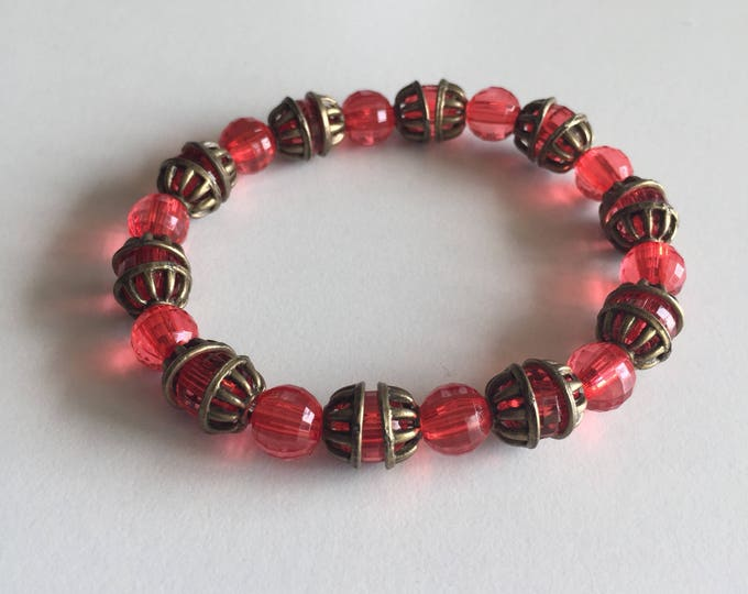 Transparent red with bronze spacer Beads Bracelet