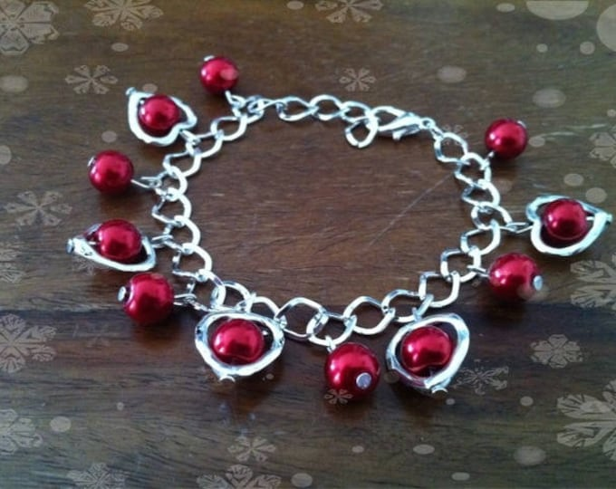Hearts with red beads charm bracelet