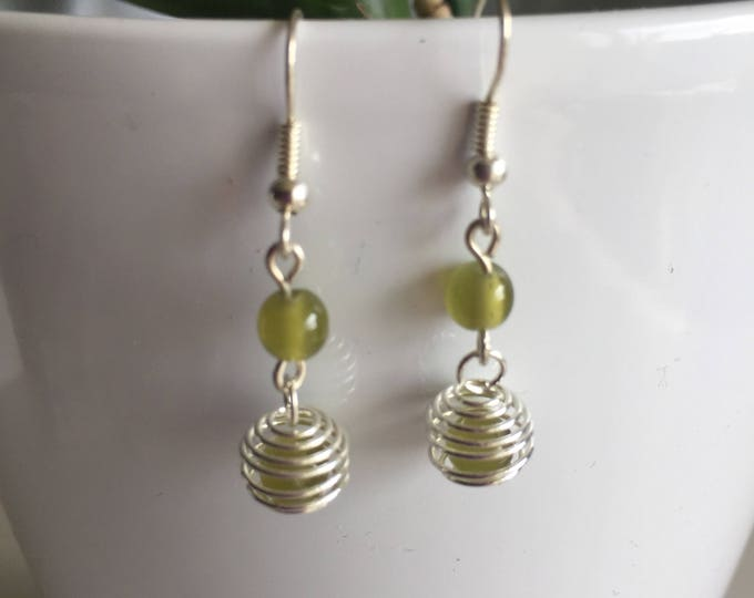 These earrings spiral khaki moss green beads