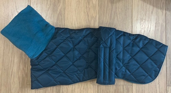 whippet waterproof winter quilted coats with a long fleece neck readymade in petrol blue
