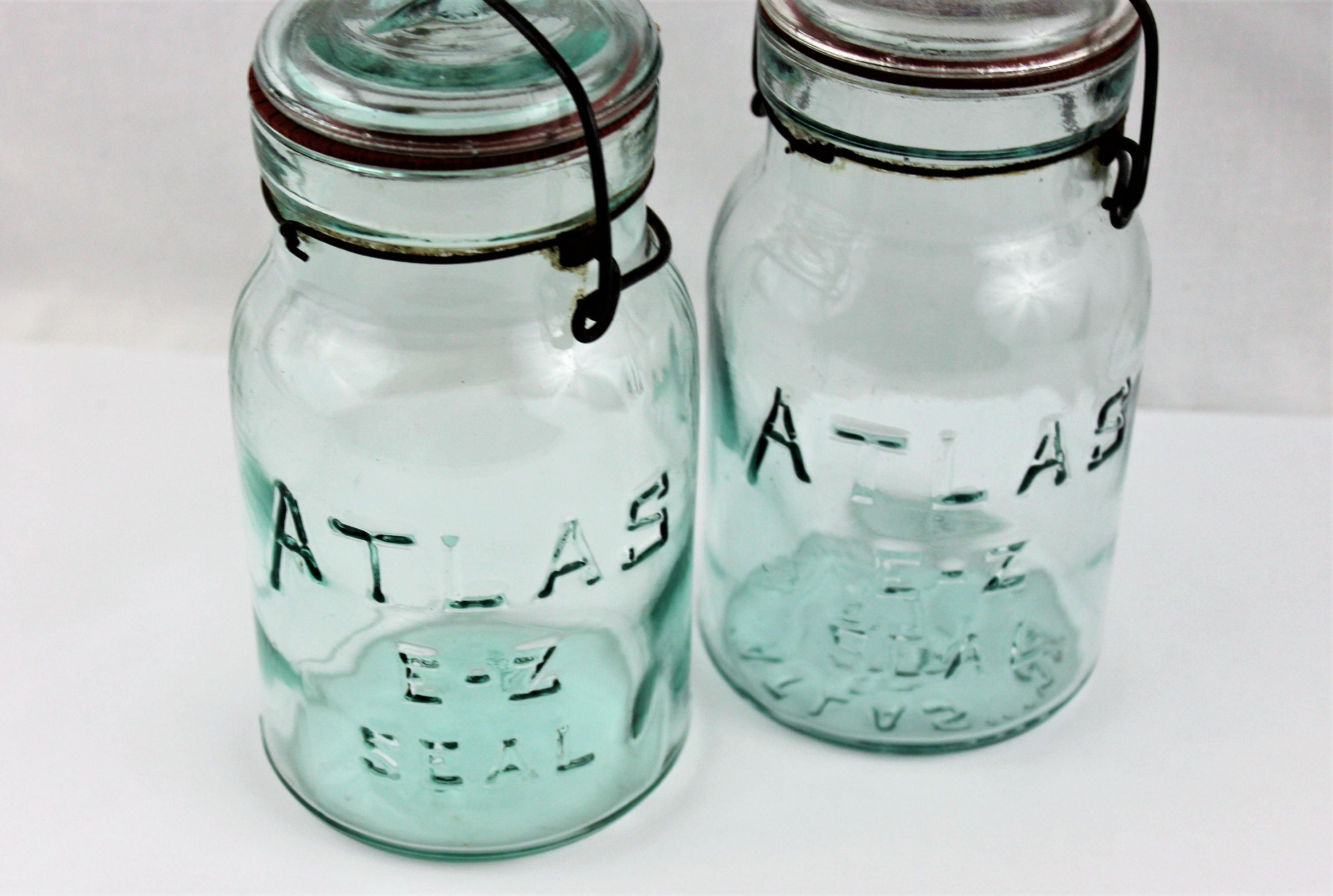 Antique Pair Of Blue Atlas E Z Seal Mason Jars With Glass Lids And