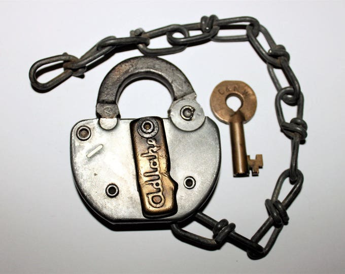 1975 Adlake Padlock C &  NW and Hollow Barrel Brass Key, Chicago and North Western Railroad