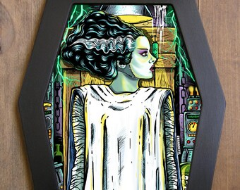 The Bride of Frankenstein coffin framed print.
