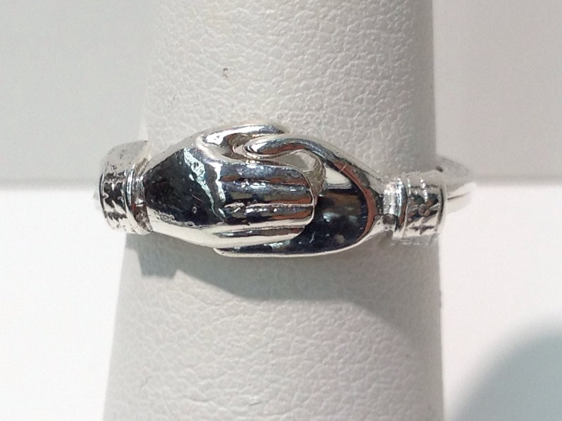Holding Hands Ring Handmade in Sterling Silver Hands Holding image 0