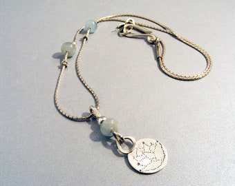 Silver lotus pendant with aquamarine bead and chain hand crafted necklace