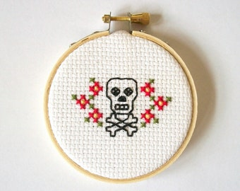 """Skull Tattoo style cross stitch -- completed 3"""" cross stitch, skull and crossbones with flowers, macabre, horror, morbid, pirate"""