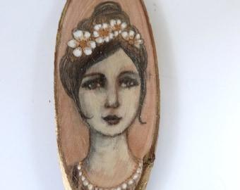 Portrait of a romantic woman on oval wood. Marguerite.