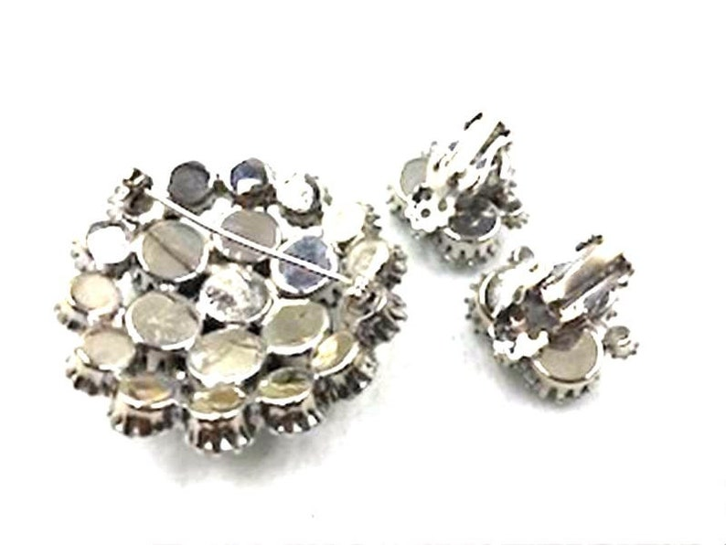 Pastel And Clear Sparkle  Demi-10680a-040119018 Swirly Crescent Rhinestone Pin and Earrings Set