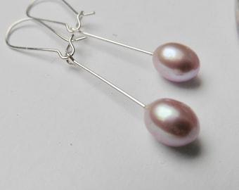 Earrings made of real pearls on hoop earrings